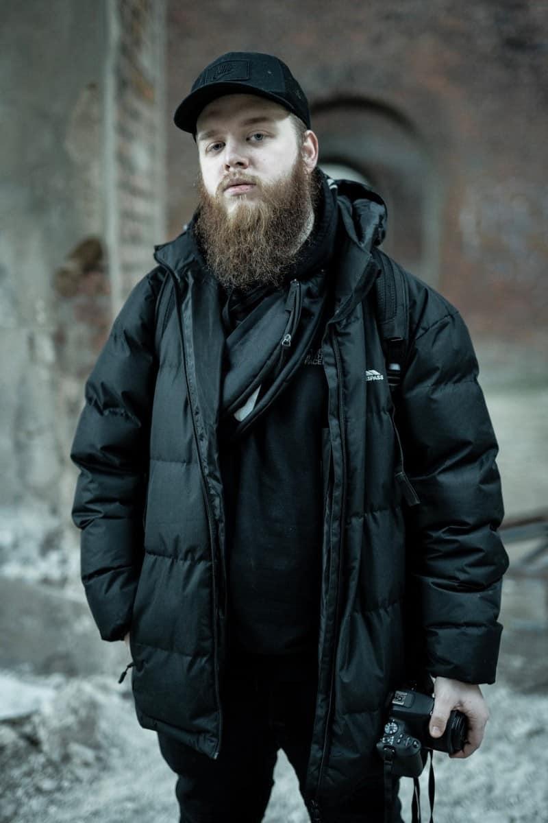 long beard man in black jacket