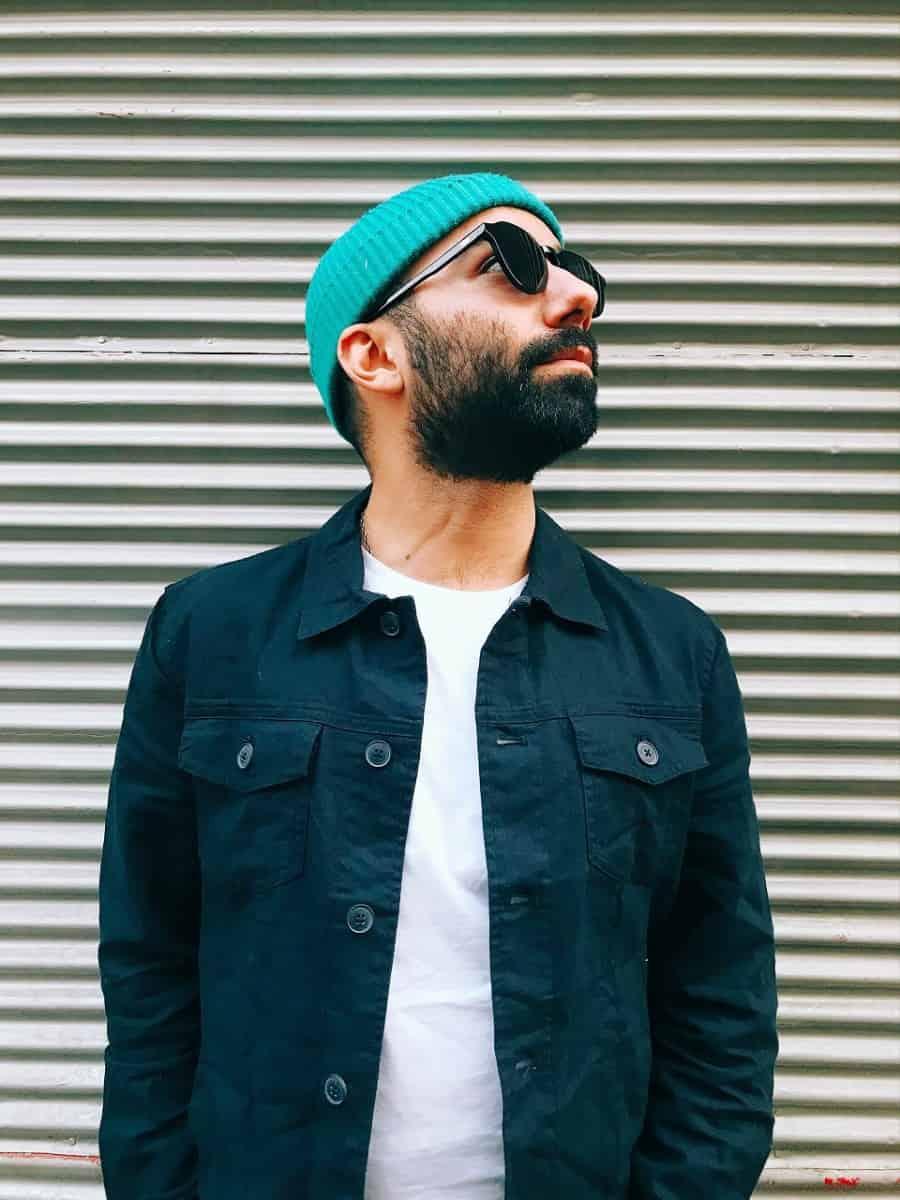 beard man wearing teal bennies