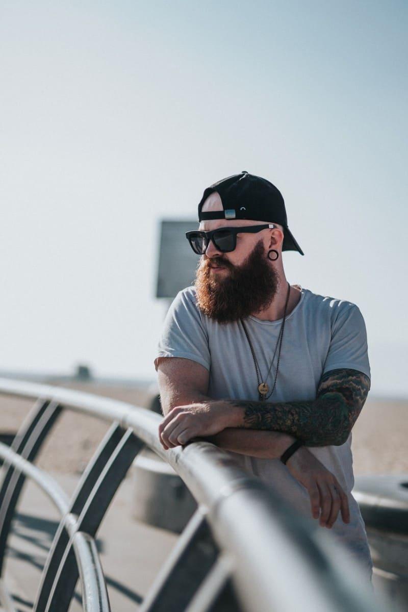 long beard man wearing black wayfarer sunglasses outdoor
